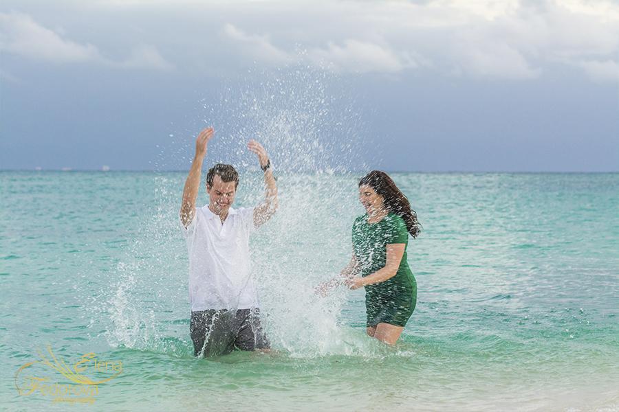 having fun couple water splashes