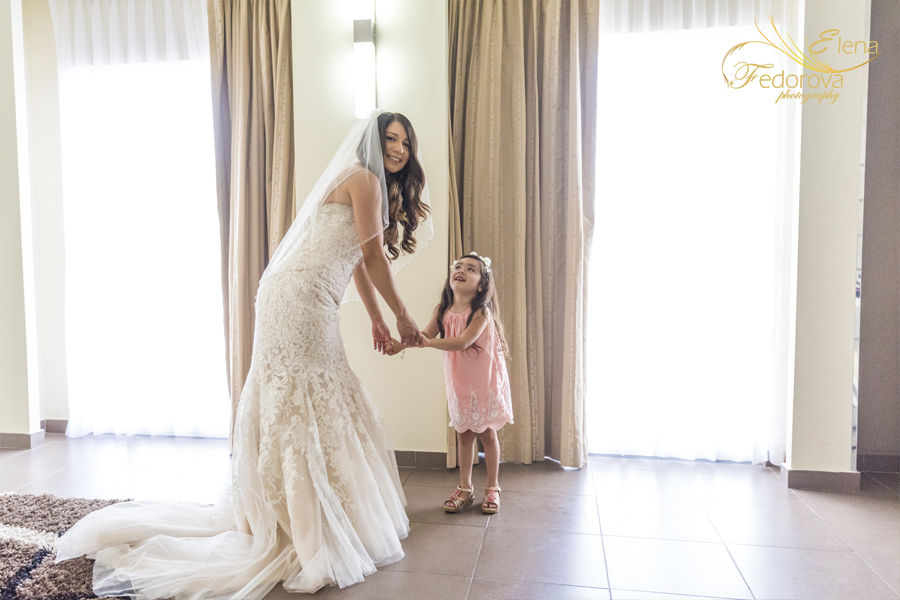 riu yucatan bride with flower girl