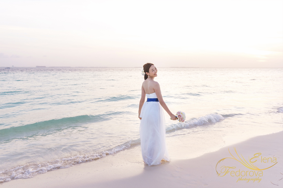 bridal portrait beach sunset