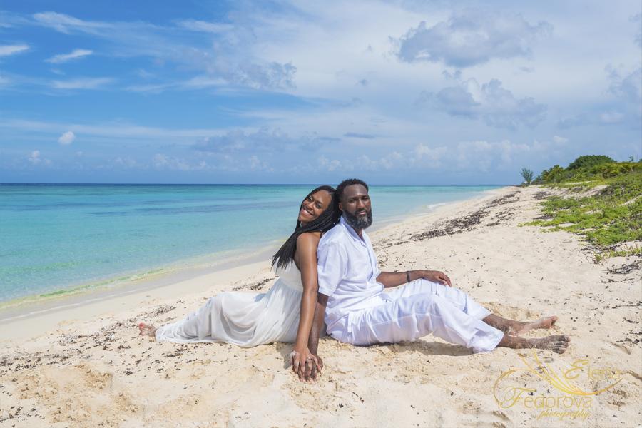couple sitting on beach Cozumel