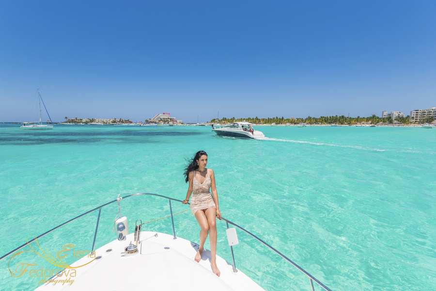 model on yacht Cancun