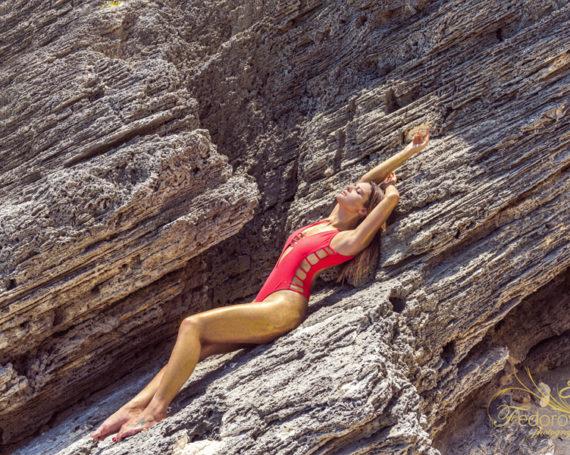 Creative photo shoot on the rocks. Golden glitter.