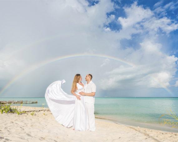 Beach photos with a rainbow on a cloudy day.