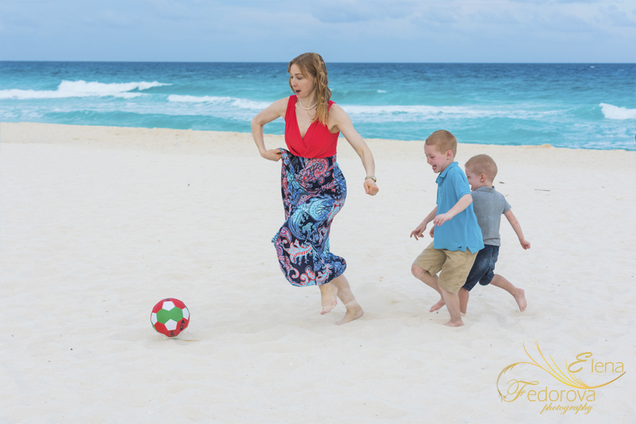 mother playing football with kids