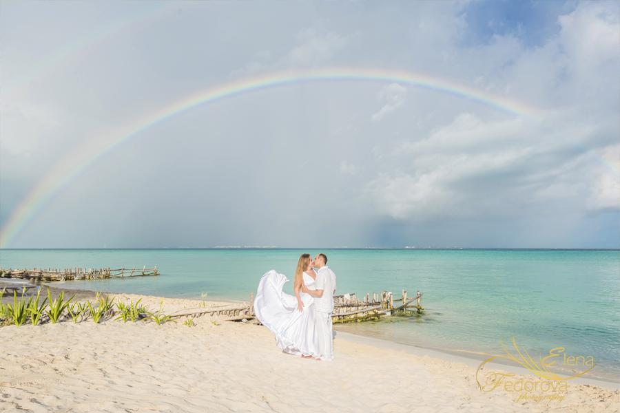 romantic couple photo with rainbow