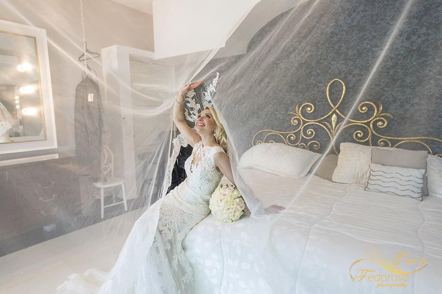 bride under veil photo