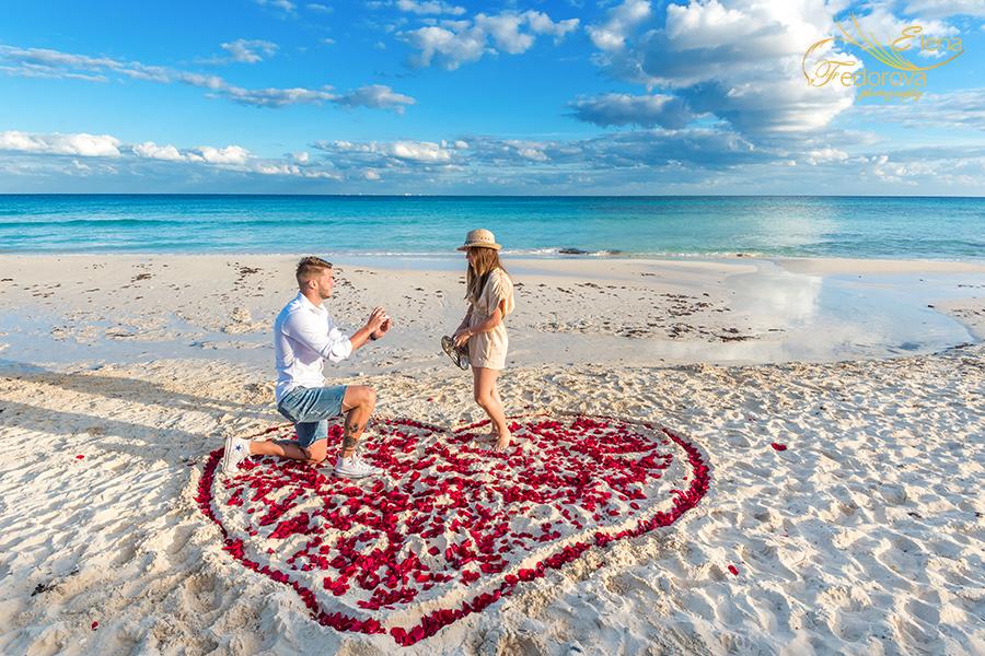 heart of rose petals beach proposal