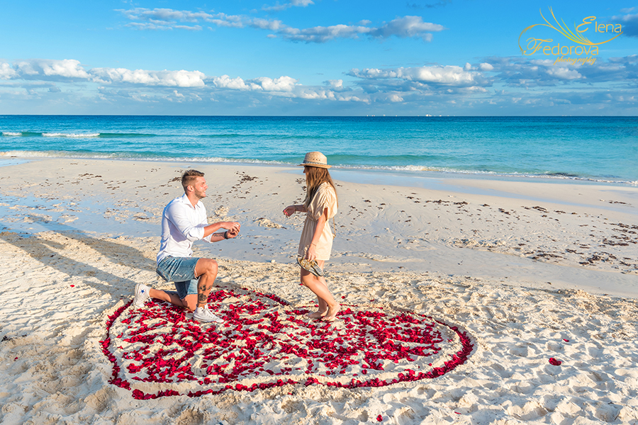 surprise proposal in heart of rose petals