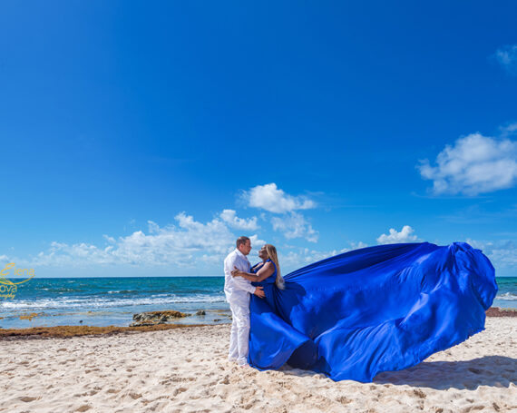 Engagement flowy dress photoshoot at the beach.